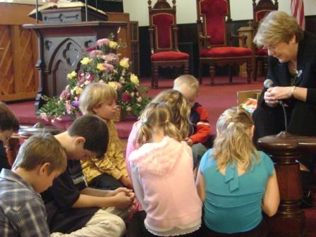Closing the children's message with prayer