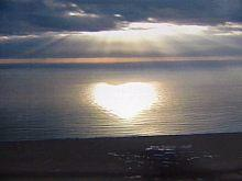 Beautiful heart shining over the lake