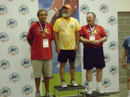 Jim receives the Silver for men's 60 thru 69 Badminton